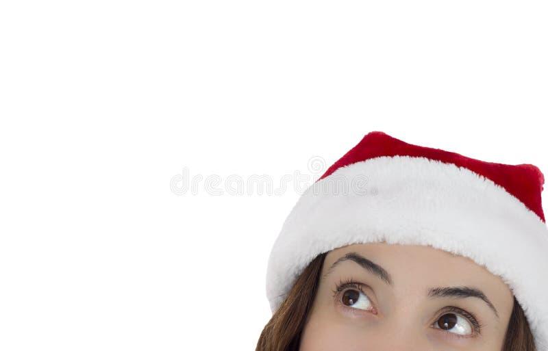 Женщина Санты смотря вверх выжидательно стоковая фотография