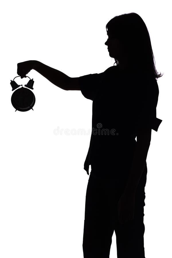 женщина силуэта будильника стоковые изображения