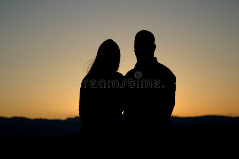 женщина силуэта 2 человек стоковая фотография rf