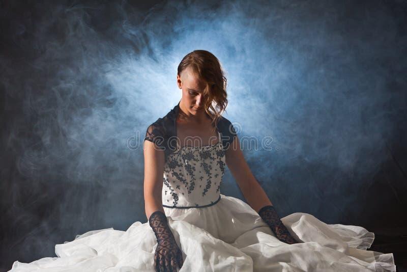 Женщина сказки в дыме стоковое фото rf