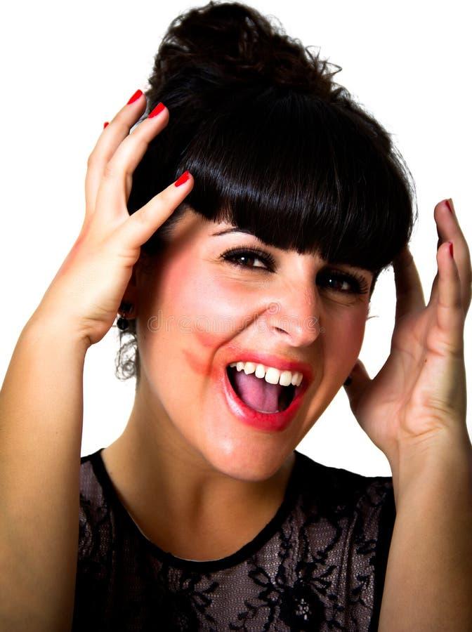 Женщина смазанная губной помадой стоковые фото