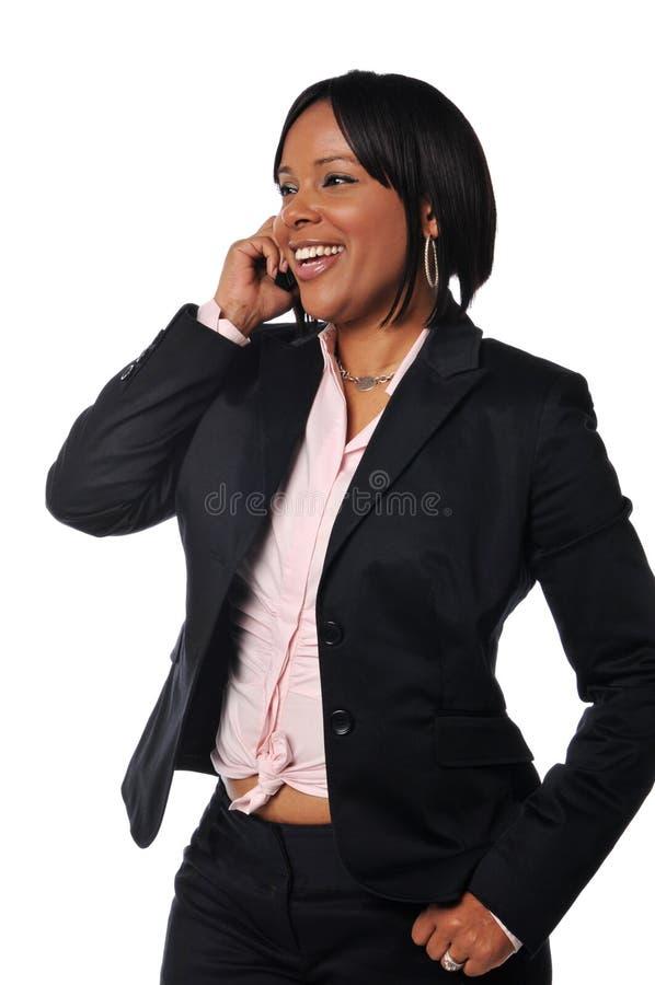 женщина сотового телефона афроамериканца стоковое изображение rf