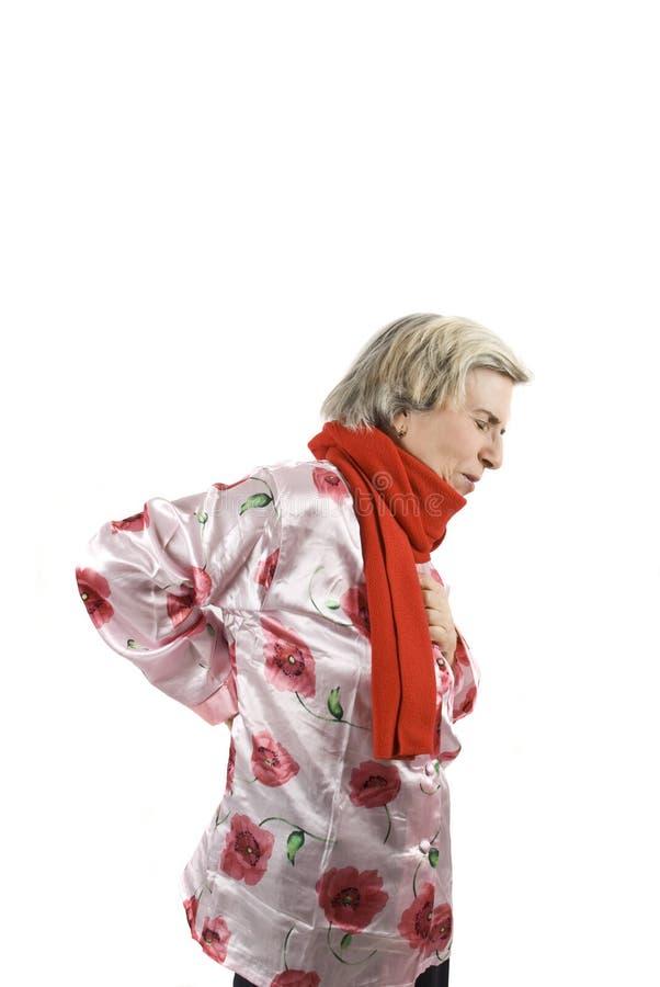 женщина старшия backache стоковая фотография