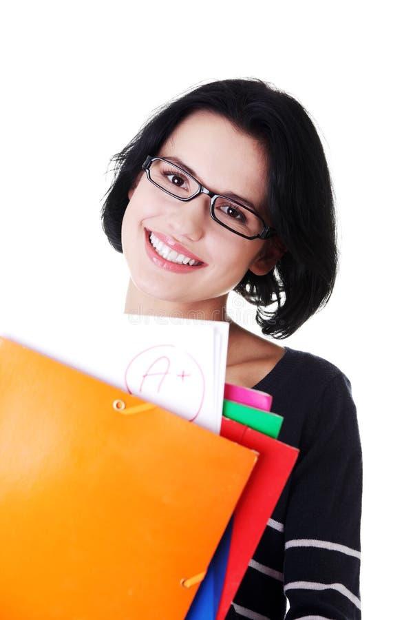 Женщина студента показывая ее совершенный результат экзамена стоковое фото rf