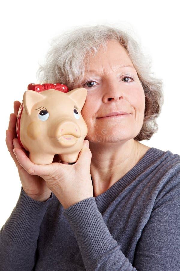 женщина счастливого удерживания piggy старшая стоковое фото rf