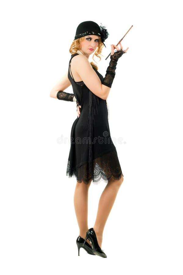 Женщина с держателем сигареты стоковое изображение