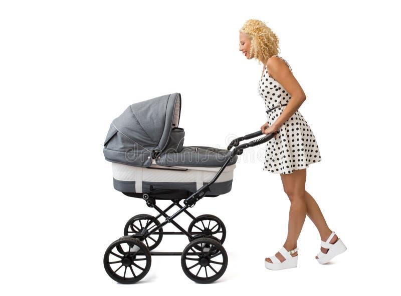 Женщина с детской дорожной коляской стоковая фотография rf