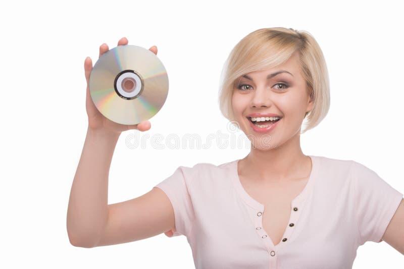Женщина с диском КОМПАКТНОГО ДИСКА. стоковая фотография rf