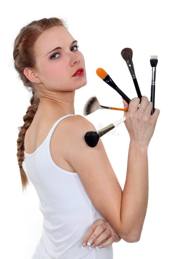 Женщина с карандашами состава стоковое изображение