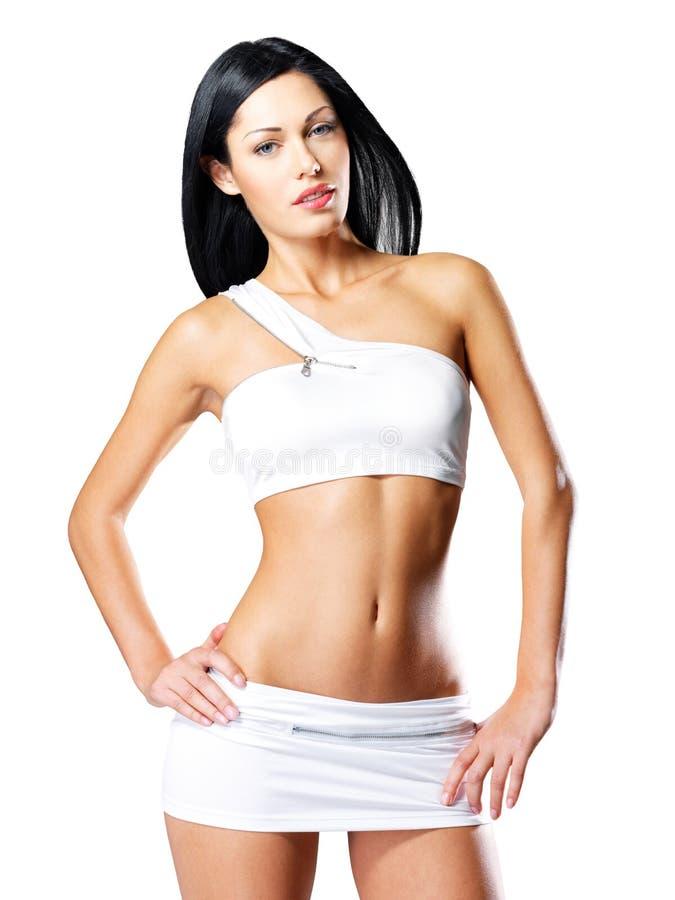 Женщина с красивым уменьшает загоренное тело стоковые изображения rf