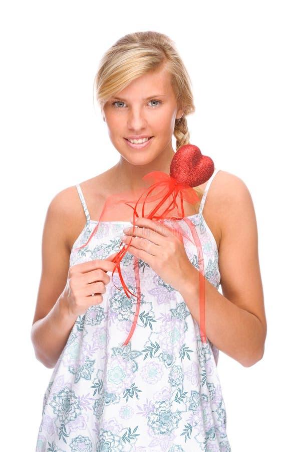 Женщина с красным сердцем стоковая фотография rf