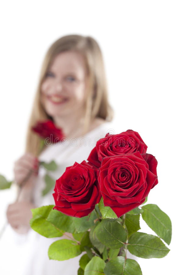 Женщина с красным roses.GN стоковое изображение