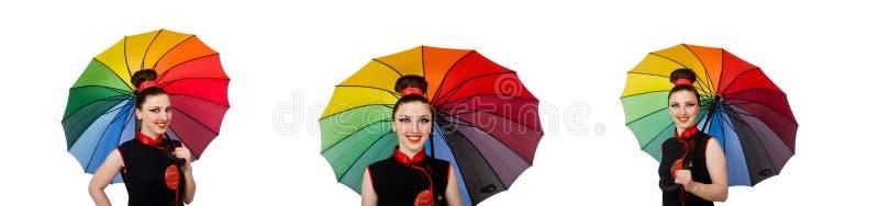 Женщина с красочным зонтиком изолированным на белизне стоковые изображения
