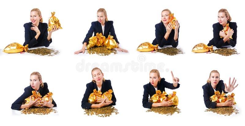 Женщина с монетками и золотыми мешками стоковое фото rf