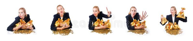 Женщина с монетками и золотыми мешками стоковое изображение