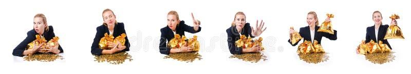 Женщина с монетками и золотыми мешками стоковая фотография rf
