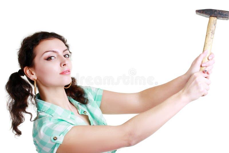 Женщина с молотком стоковая фотография