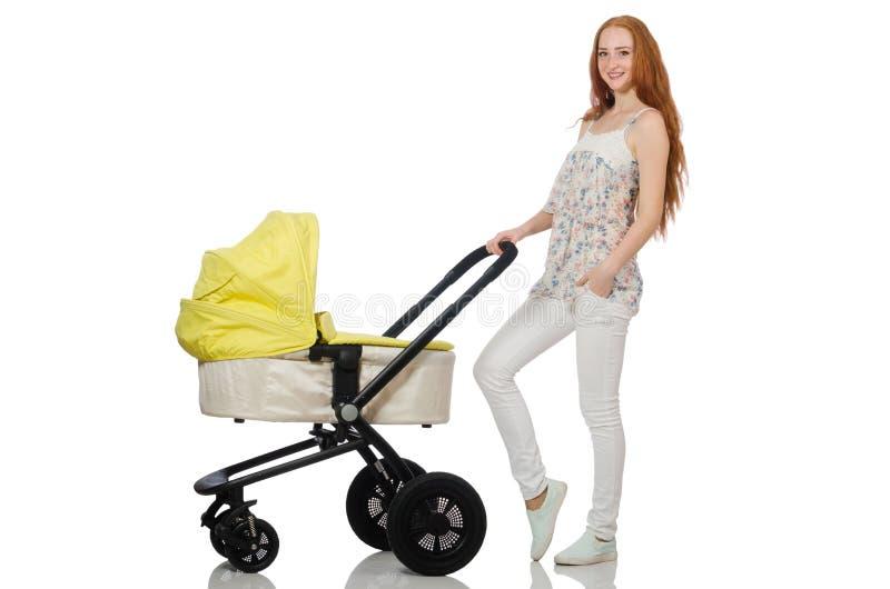 Женщина с младенцем и pram изолированный на белизне стоковые изображения