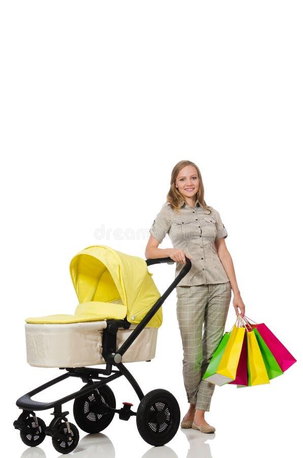 Женщина с младенцем и pram на белизне стоковые фотографии rf