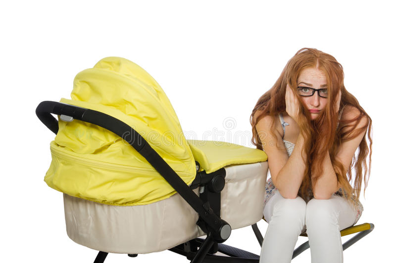 Женщина с младенцем и pram на белизне стоковые изображения