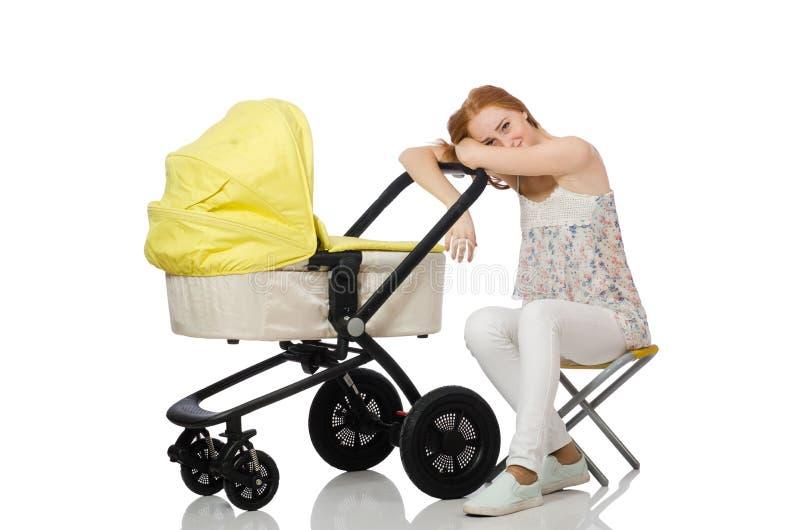 Женщина с младенцем и pram стоковая фотография