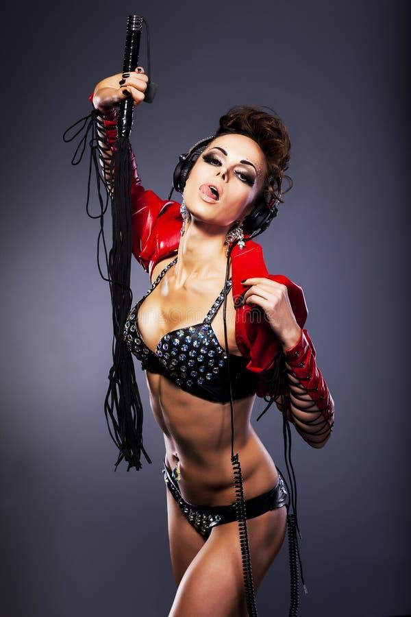 Сексуальная девушка с плеткой