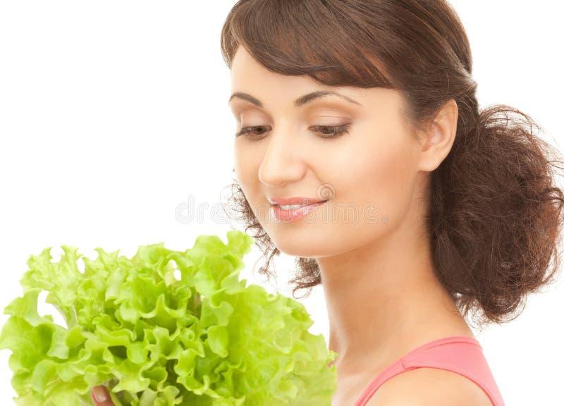 Женщина с салатом стоковые фото