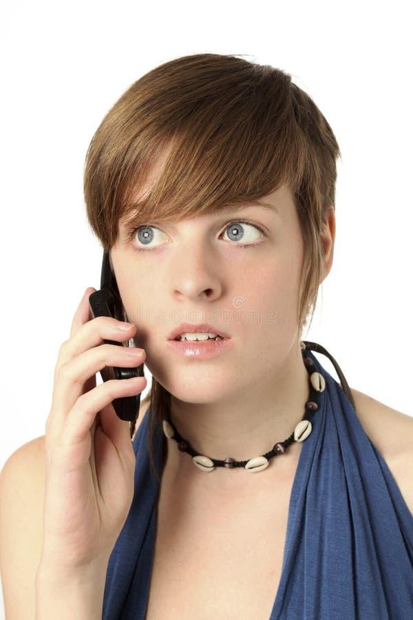 Женщина с сотовым телефоном стоковое фото