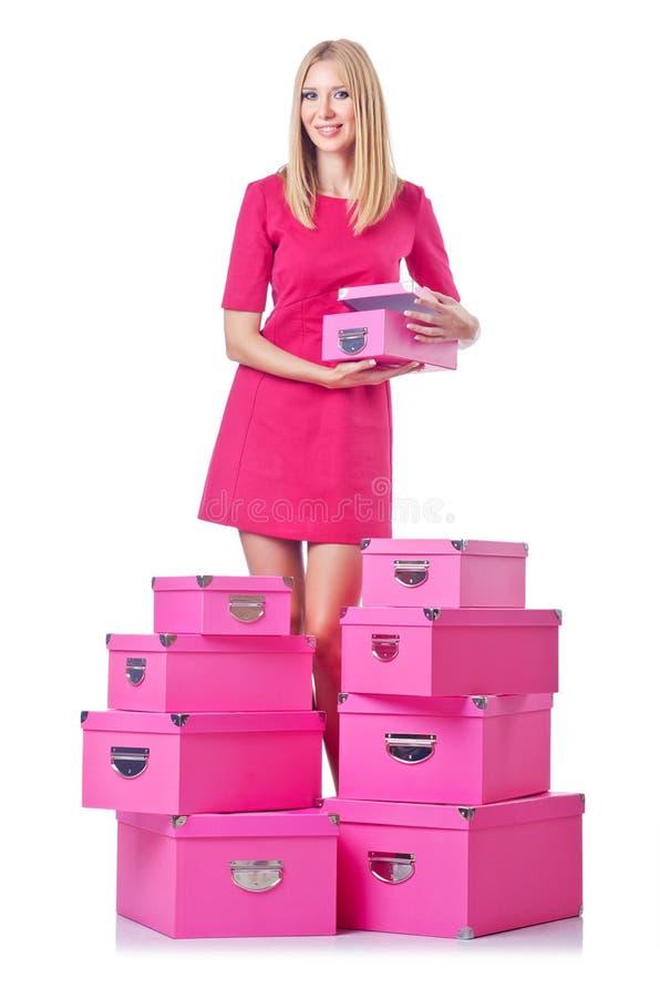 Женщина с стогом giftboxes стоковые изображения