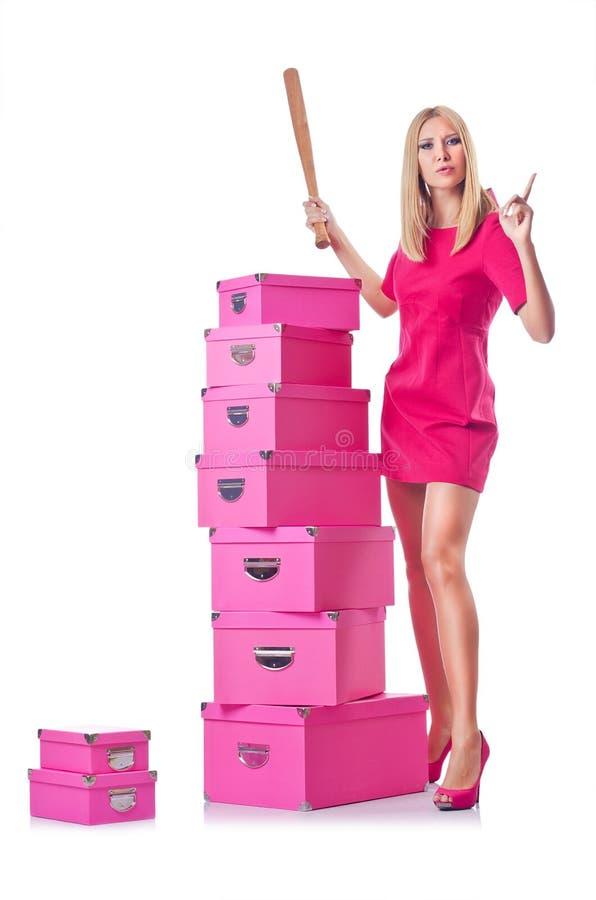 Женщина с стогом giftboxes стоковое фото