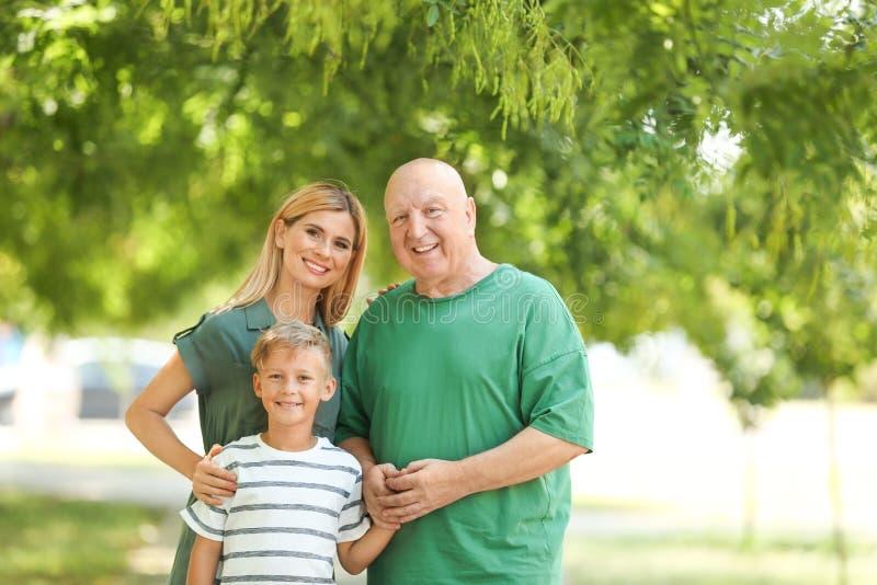 Женщина с сыном и пожилым отцом стоковое фото rf