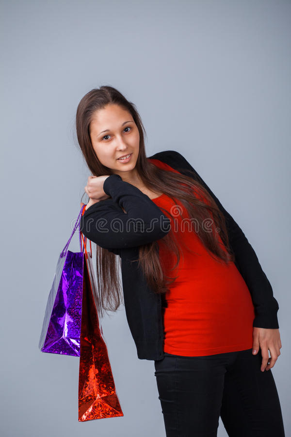 Женщина с хозяйственной сумкой стоковое фото