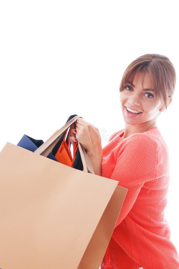 Женщина с хозяйственными сумками стоковая фотография