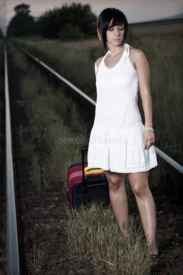 Женщина с чемоданом стоковая фотография rf