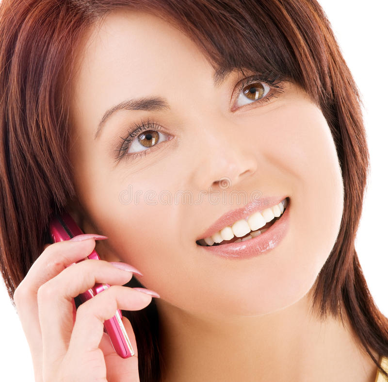 женщина телефона клетки счастливая стоковое изображение