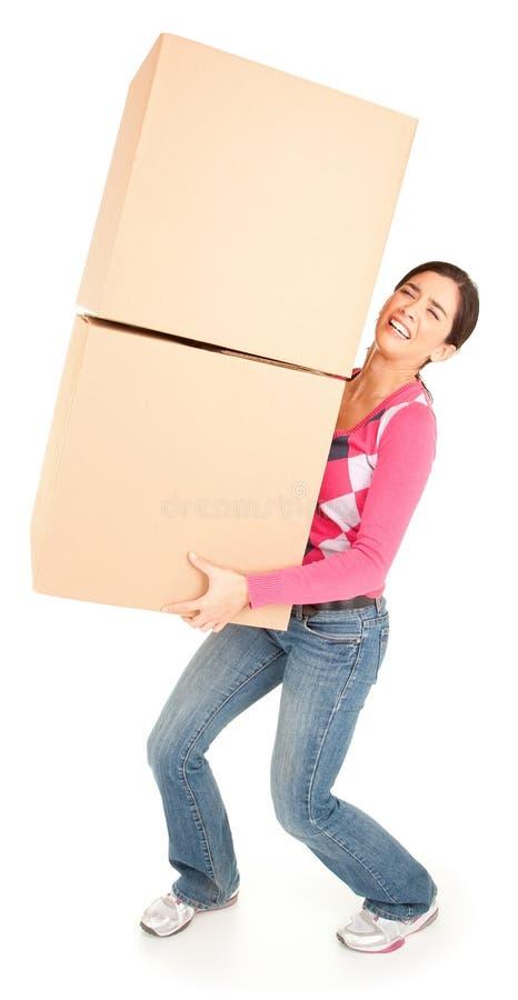 Женщина тягостно нося коробки стоковое изображение rf