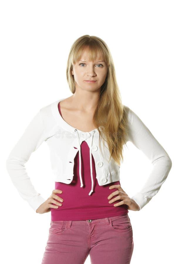 женщина уверенно джинсыов розовая стоковая фотография rf