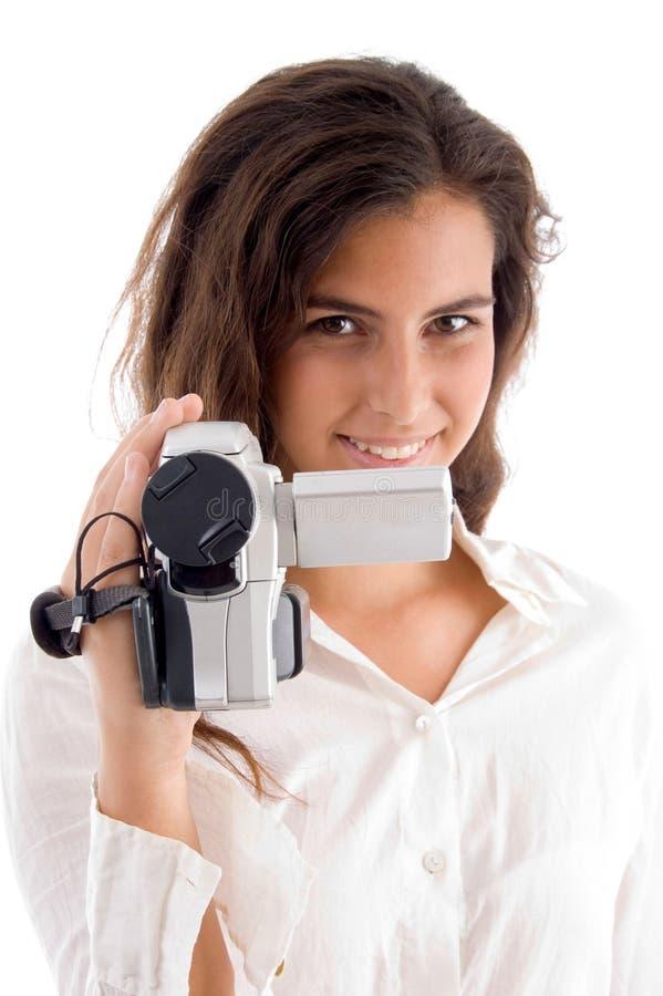 женщина удерживания камеры сь видео- стоковая фотография rf