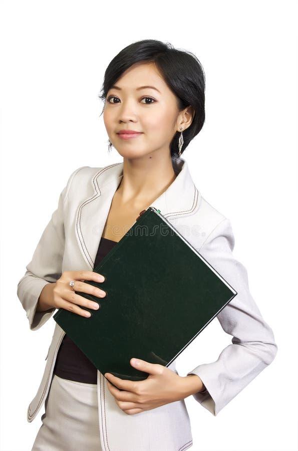 женщина удерживания книгоиздательского дела стоковое фото rf