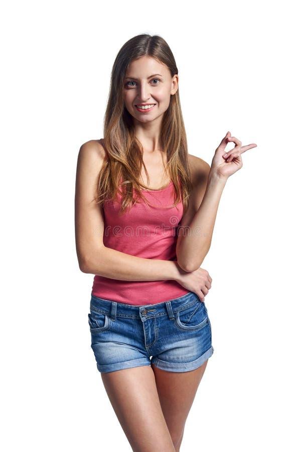 Женщина указывая палец на пустой космос экземпляра стоковая фотография rf