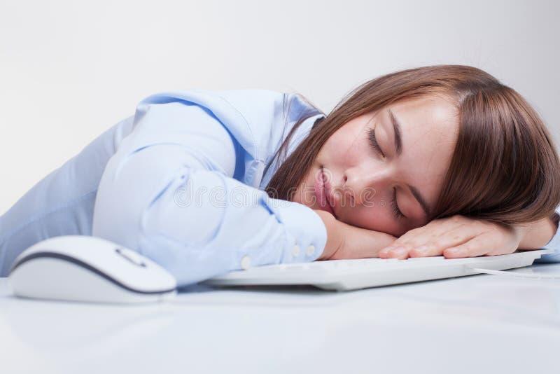 Женщина утомлянная на работе стоковое изображение
