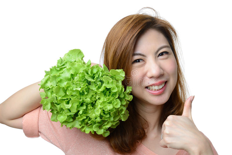 Женщина улыбки азиатская дает большой палец руки к овощу дуба зеленого цвета гидропоники стоковые фото