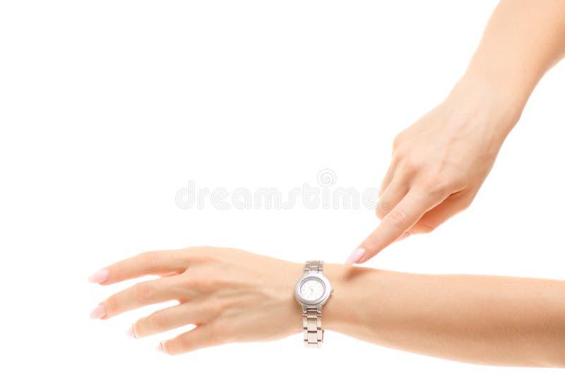 Женщина часов в наличии вручает изоляцию стоковые изображения rf