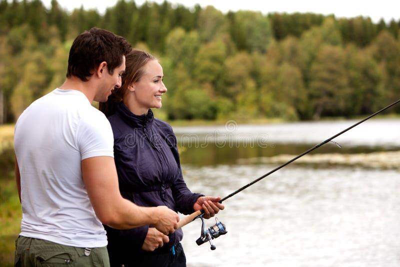 женщина человека рыболовства стоковое изображение