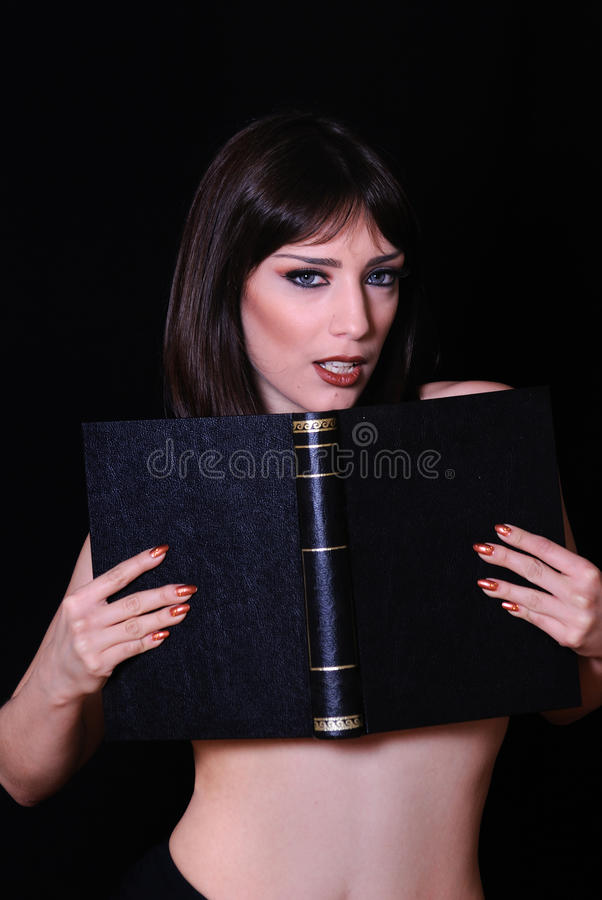 женщина черной книги сексуальная стоковое изображение