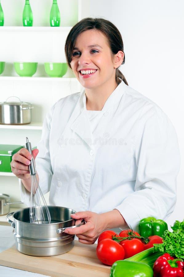 женщина шеф-повара счастливая стоковые фото