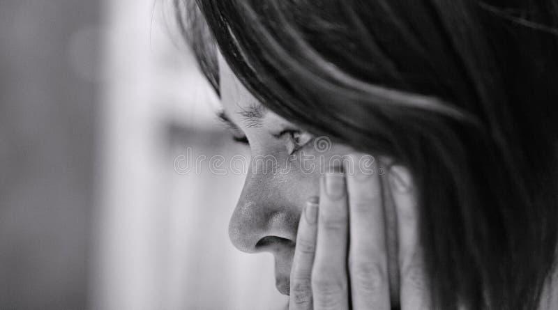 женщина despair унылая стоковое фото rf