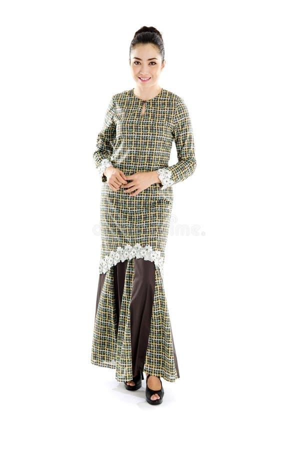 Женщина Malay в традиционном платье стоковые фотографии rf