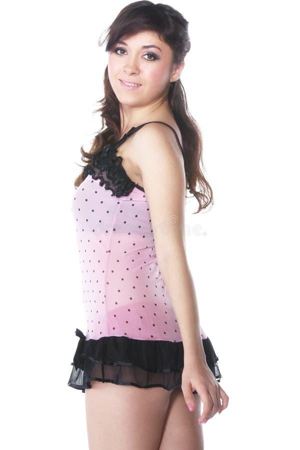 женщина sideview платья розовая стоковые изображения rf