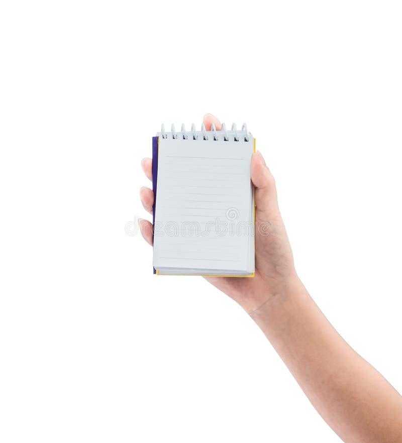 Женщины вручают держать тетрадь чистого листа бумаги стоковая фотография